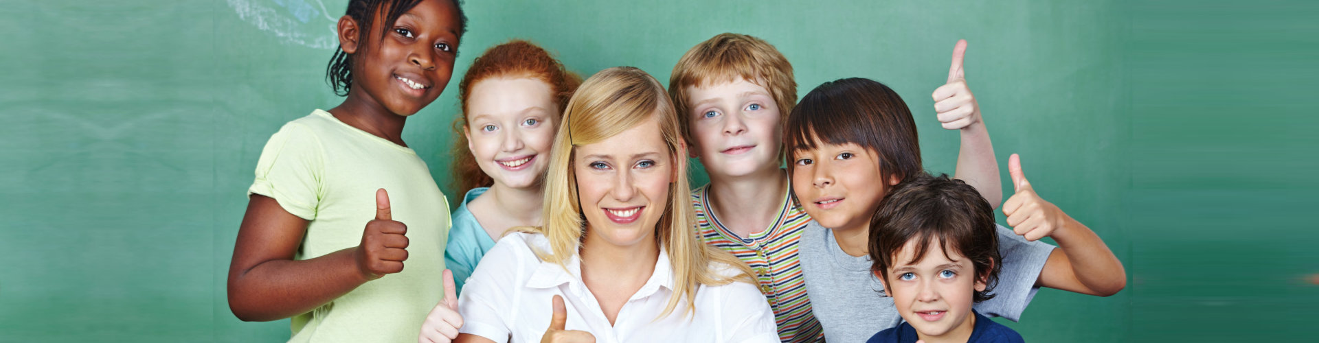 teacher with her students smiling